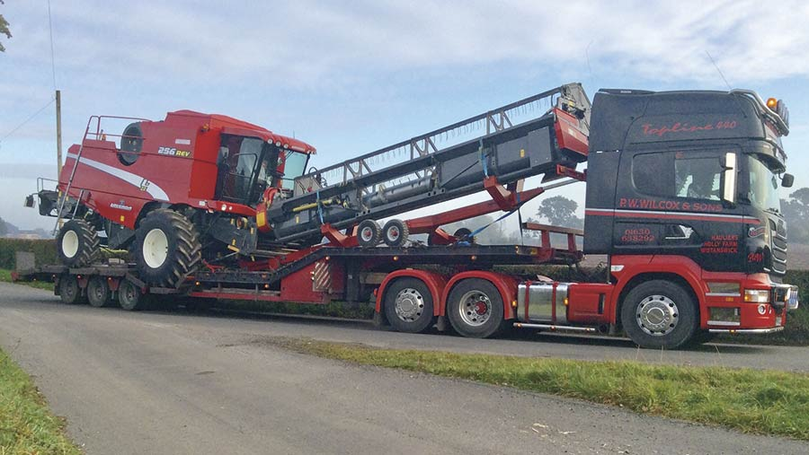 A Laverda combine is transported by truck