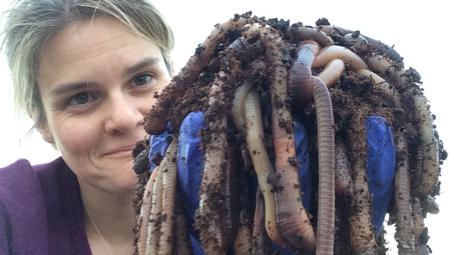 Dr Stroud holds a handful earthworms