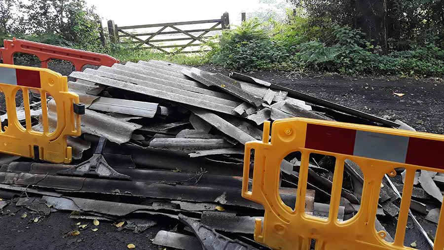 Asbestos waste fly-tipped next to farm gate