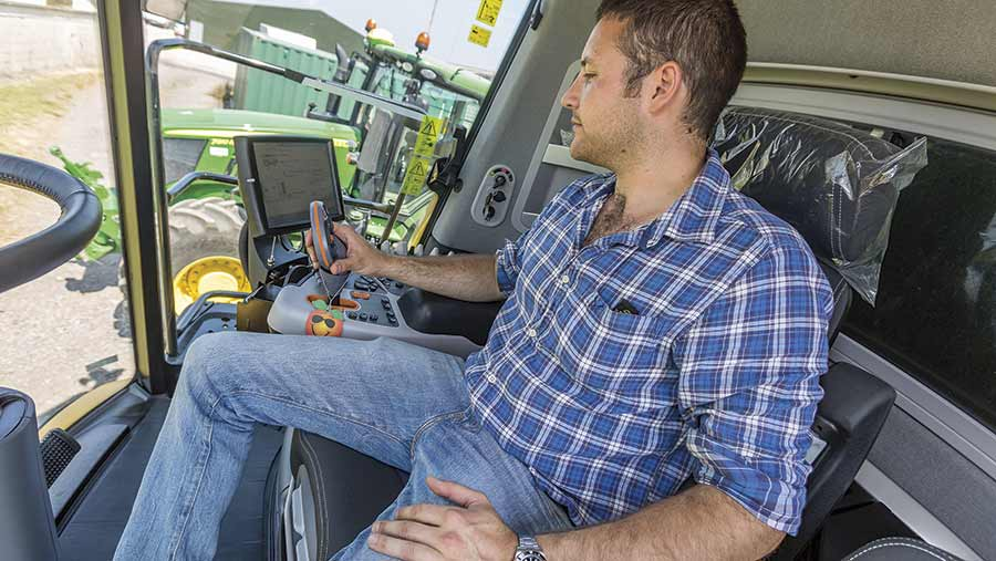 Damien Burnell in his combine harvester