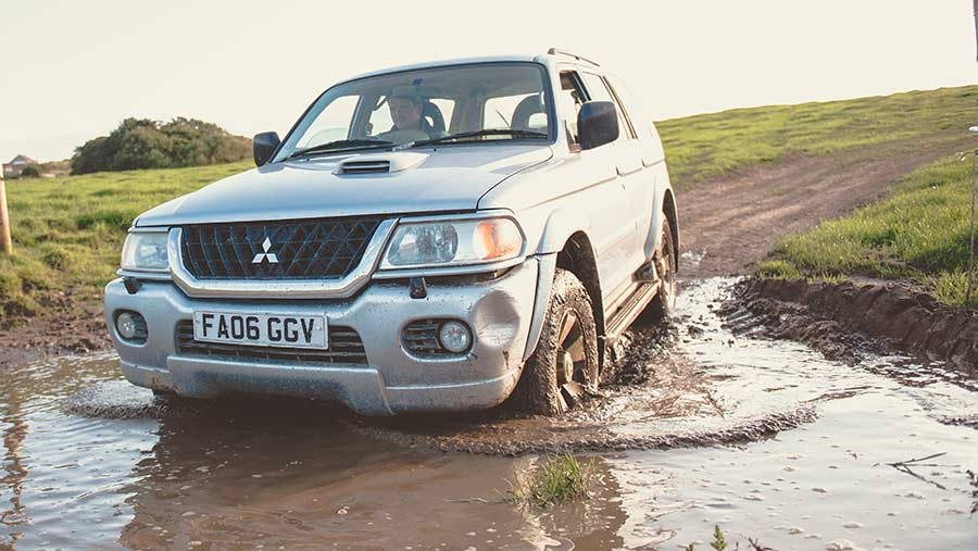 JohnJo driving his 4x4 through a large puddle