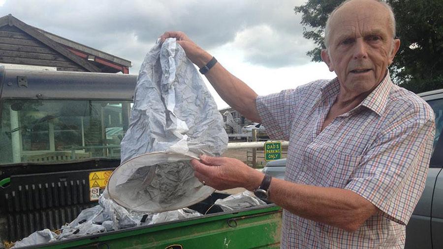 Rowland Blackwell holds a used sky lantern