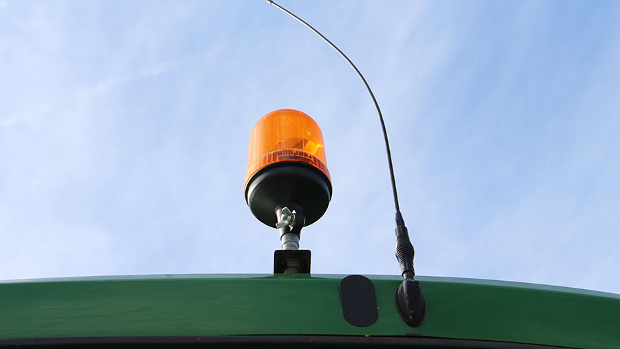 A beacon light on a tractor