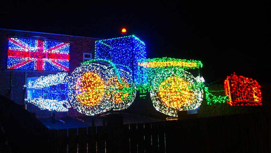 A tractor and plough made out of Christmas lights by Andrew Wilkinson