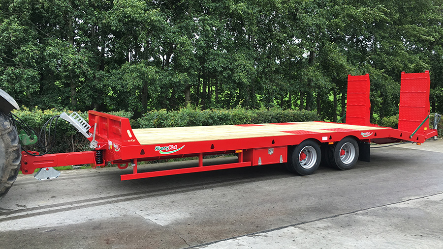 A SlurryKat trailer being towed on a road