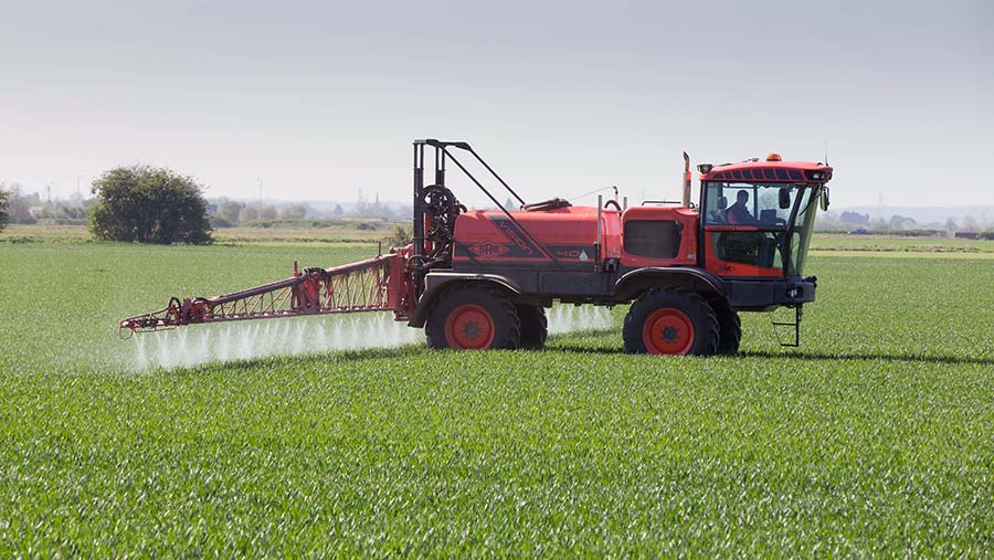 Spraying T1 in wheat © Tim Scrivener