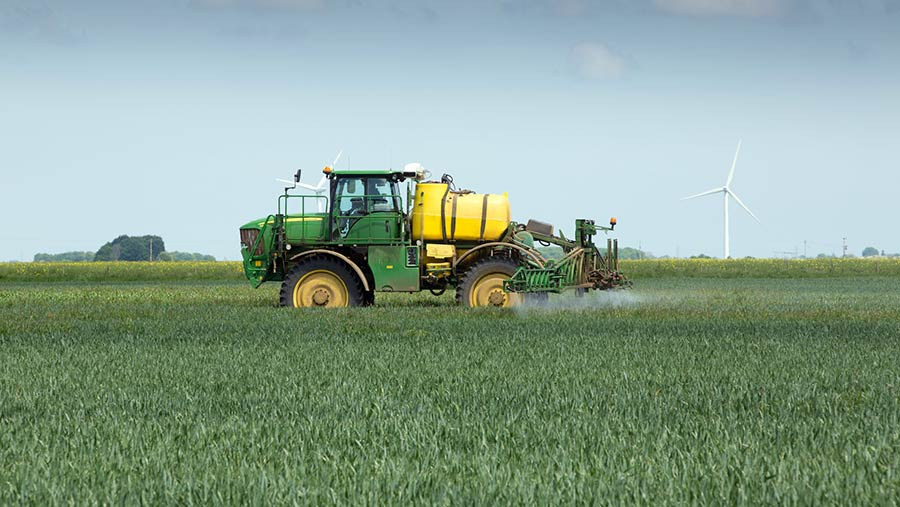 Spraying wheat at T2 fungicide timing © Tim Scrivener