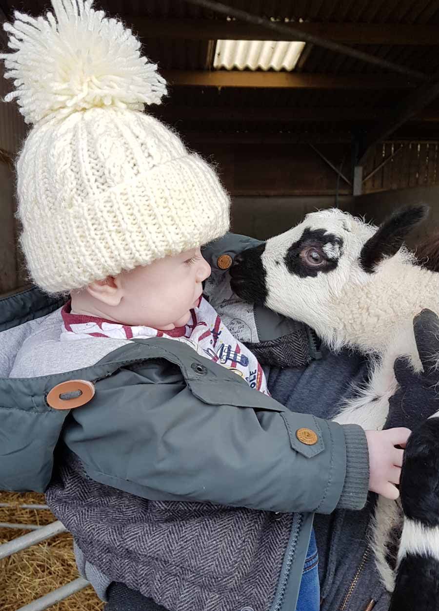 Baby with lamb