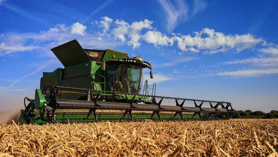 Combine cutting wheat © Tom Hadley