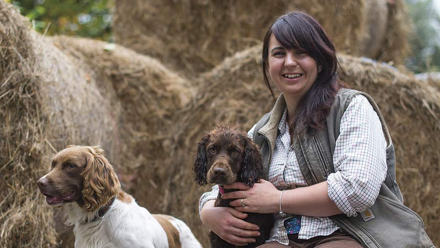 Jess Jeans with hay bales and dogs
