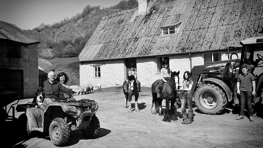 A black-and-white images shows Roland Price on a UTV with two people riding horses to the right