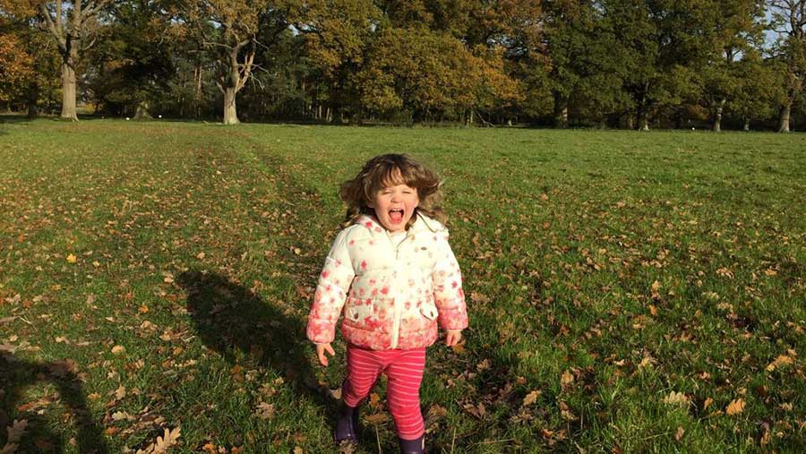 Will's daughter Eve in a field