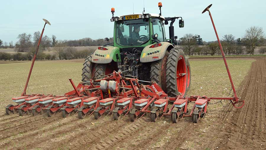 A drill passes over winter barley