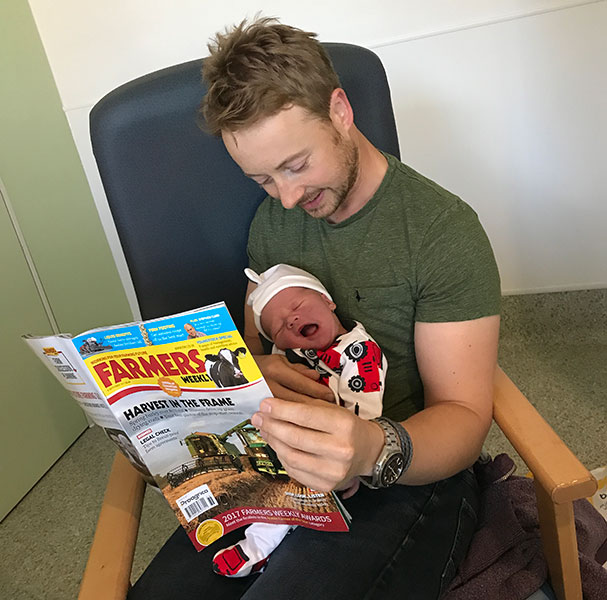 David Jessop with his new baby boy and Farmers Weekly