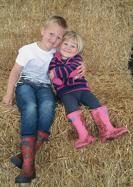 Eddie and Molly Rowlands sat on a straw bale