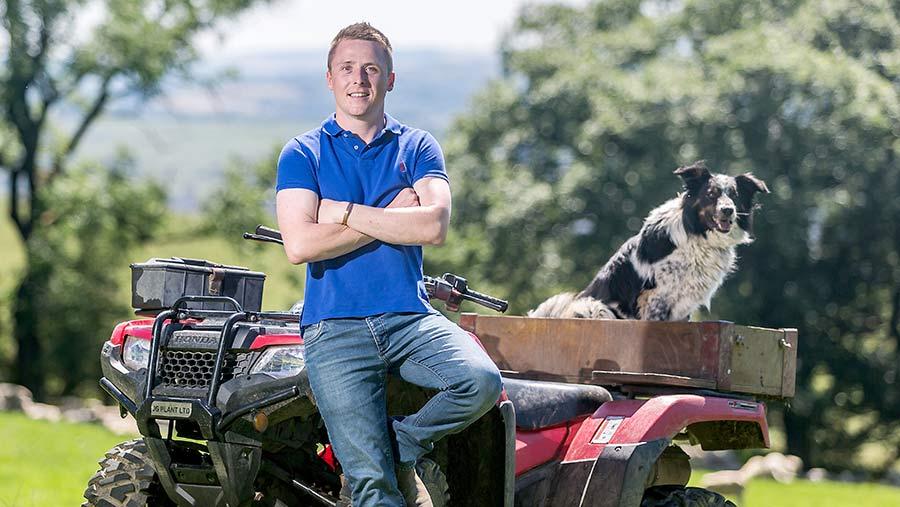Jacob Anthony sits on an ATV alongside a sheepdog