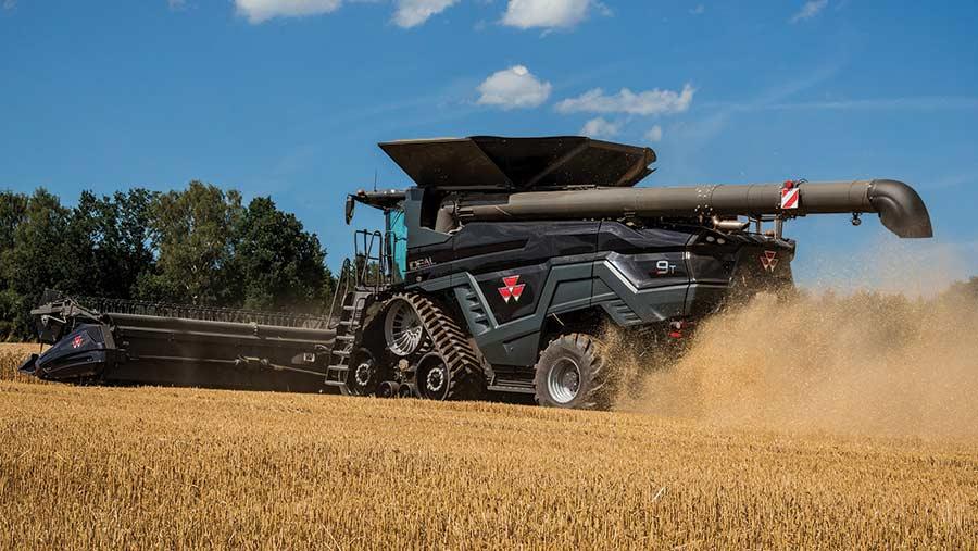 A Massey Ferguson Ideal 9T combine works in a field