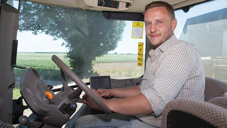 Neill Craig sitting in a tractor cab