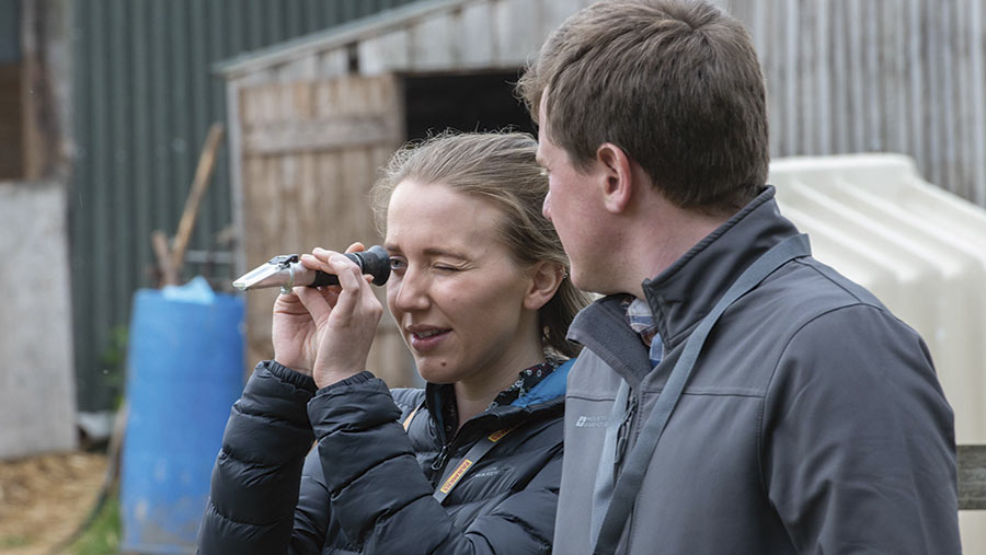 Man and woman using a refractometer