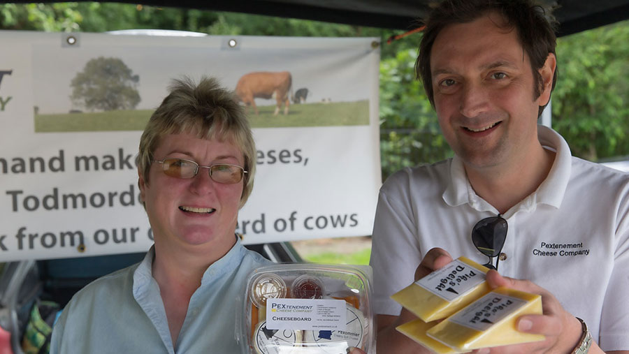 Sandra Evans and Carl Warburton hold some cheese