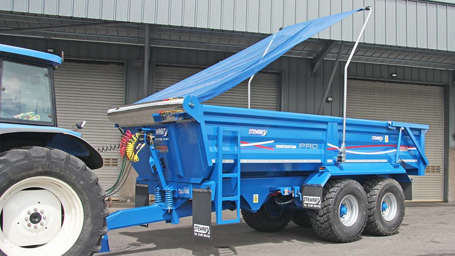 A Stewart Construction Pro trailer equipped with a Transcover mesh load covering system.