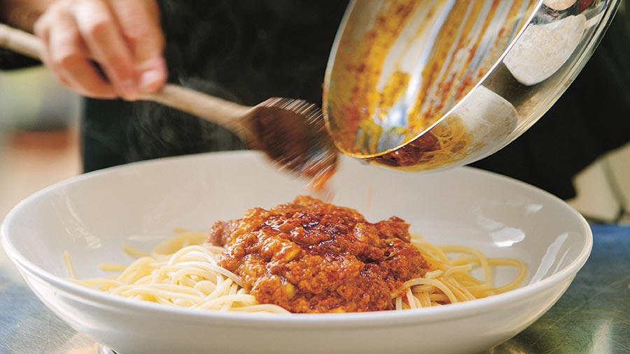 Spaghetti bolognaise being served up