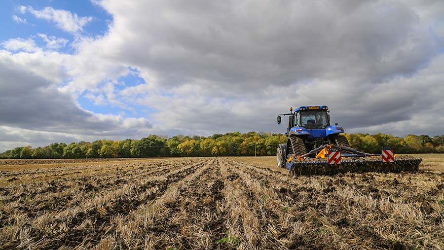 New Holland tractor cultivating land © Will Jones