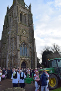 A group of churchgoers at a Plough Sunday celebration