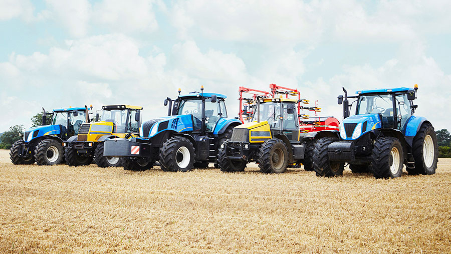 Line of tractors in a field