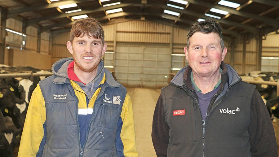 Bryn Williams stands with his father Paul in a dairy shed