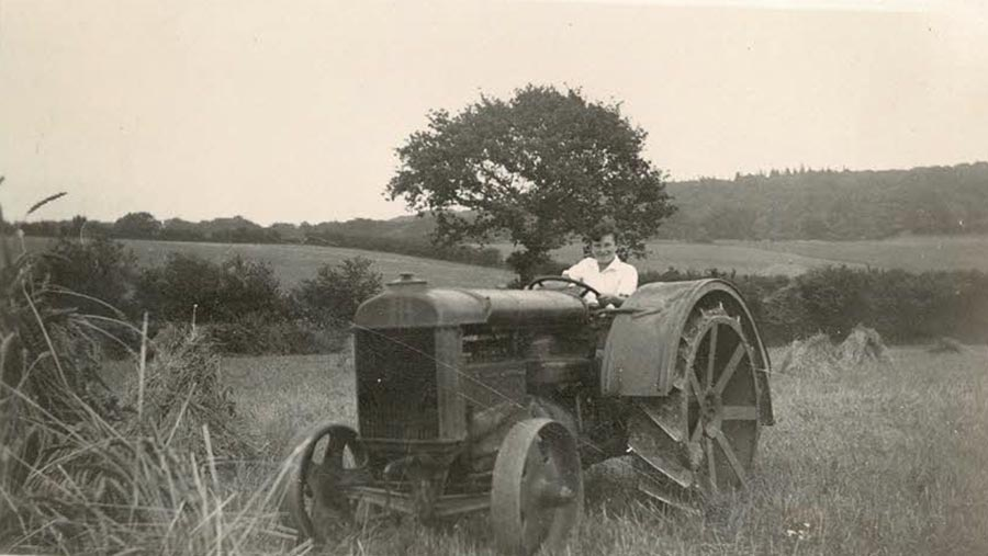 Cyril Cummins driving Fordson tractor