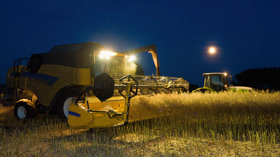 Combine harvester working at night