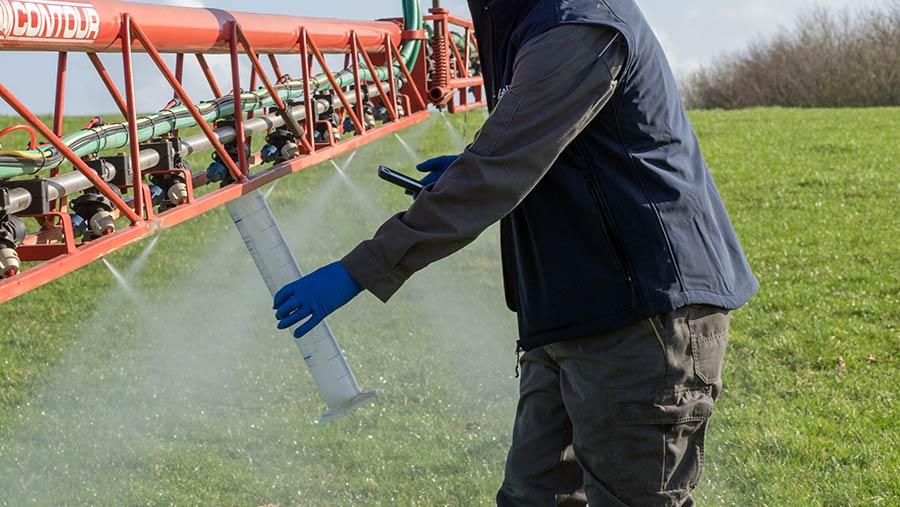 Checking sprayer nozzle output