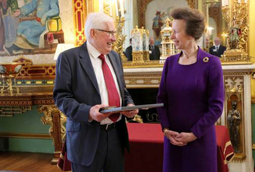 Barry Wilson holds an award while standing next to Princess Anne
