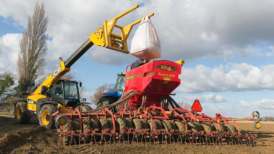 Loading spring barley seed into a drill © Tim Scrivener