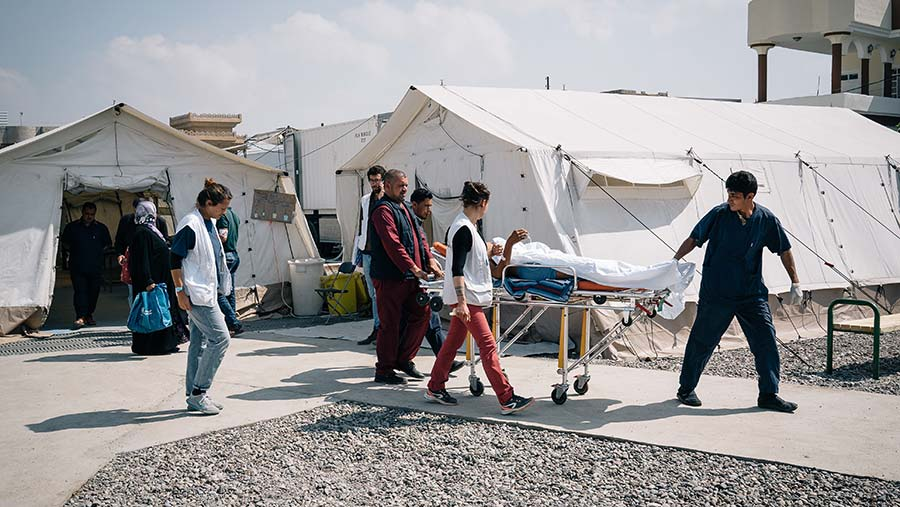 A wounded person being treated by MSF workers