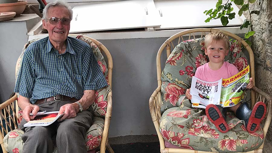 Grandad and child reading Farmers Weekly