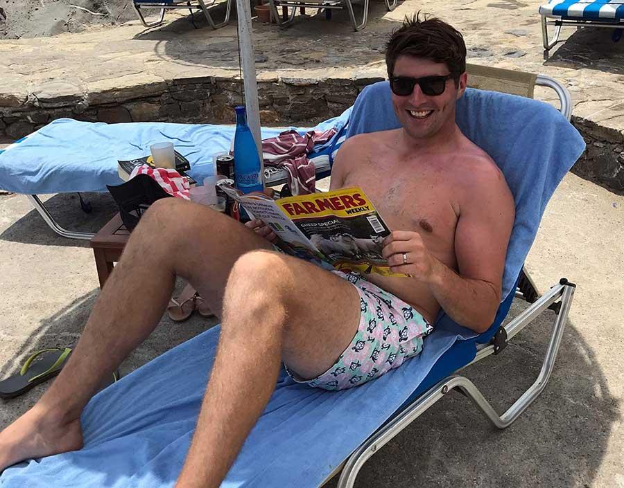 Man reading Farmers Weekly on honeymoon