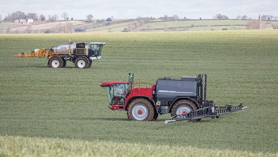 Two sprayers in a field
