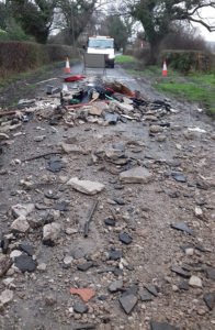 Fly-tipping in a rural road