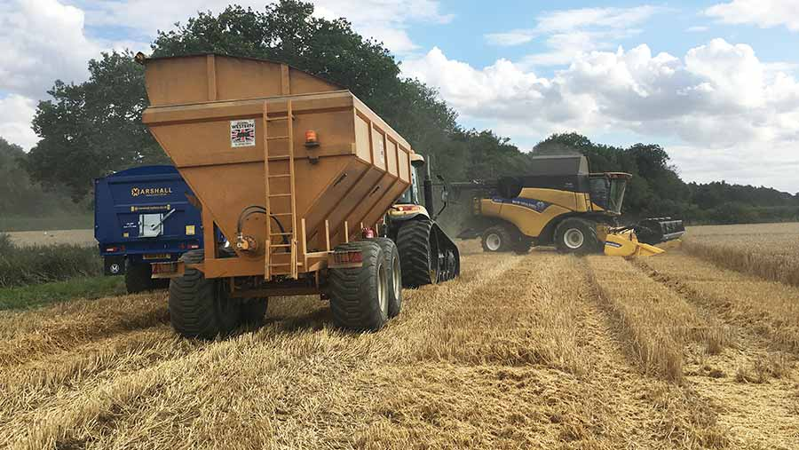 A chaser bin works in a field