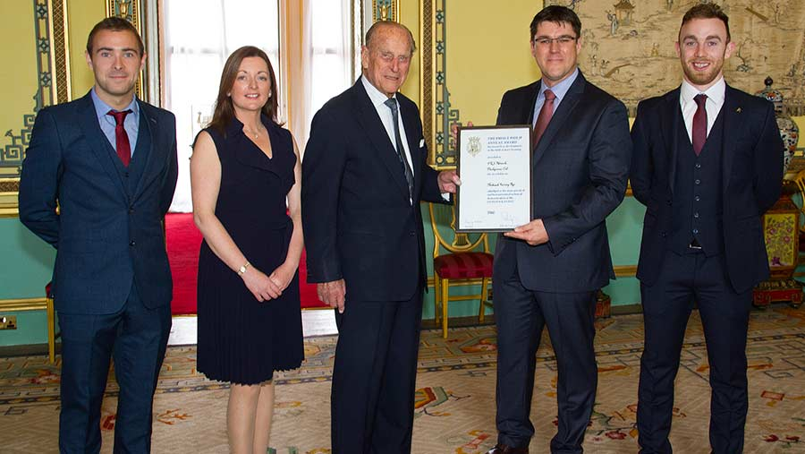 His Royal Highness Prince Philip presents the RABDF Prince Philip Award to the Herdwatch team, from left, Eoin Moloney, Jane Marks, Fabien Peyaud and James Greevy