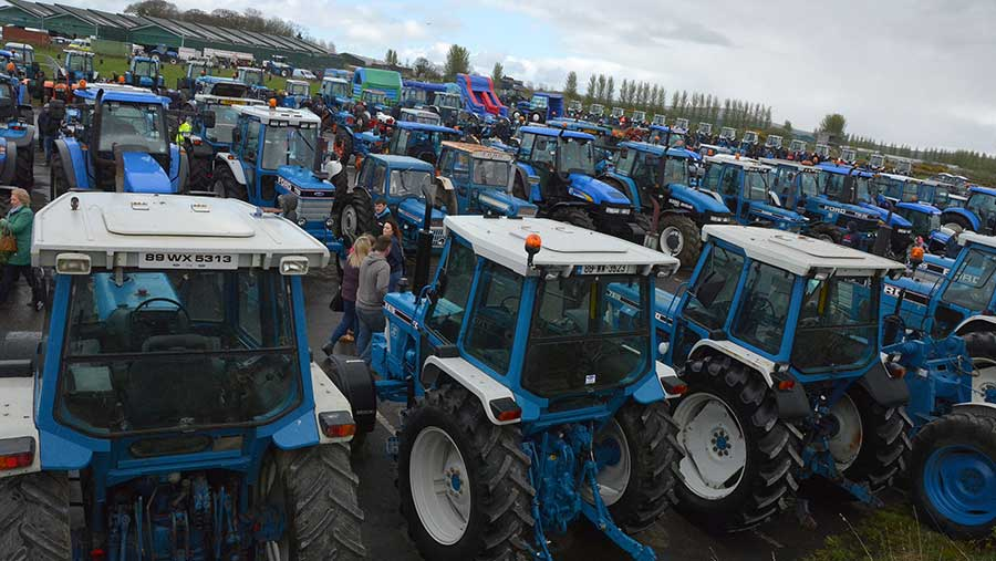 Rows of Ford tractors