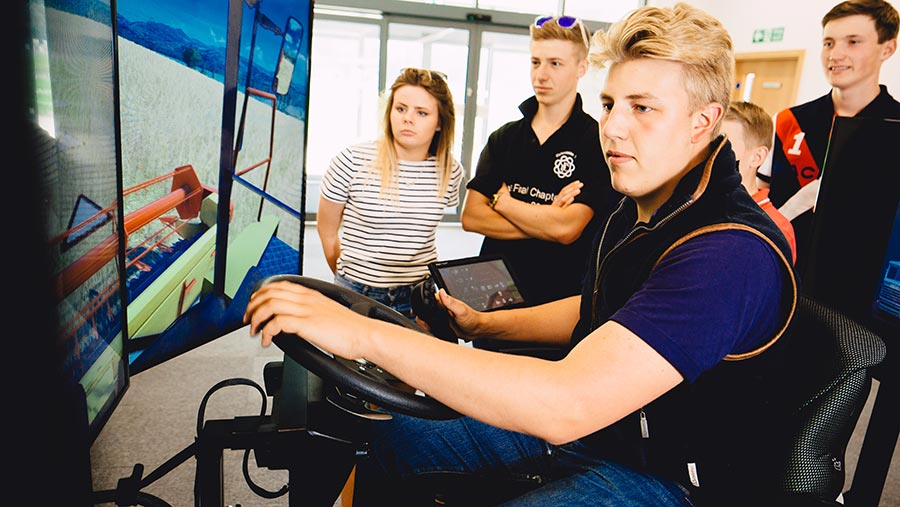 Students using tractor driving simulator © Bishop Burton and Riseholme Colleges