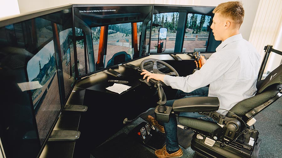 Student using tractor driving simulator © Bishop Burton and Riseholme Colleges