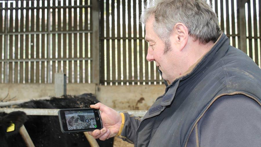 Oliver Edwards monitors CCTV feed via mobile phone
