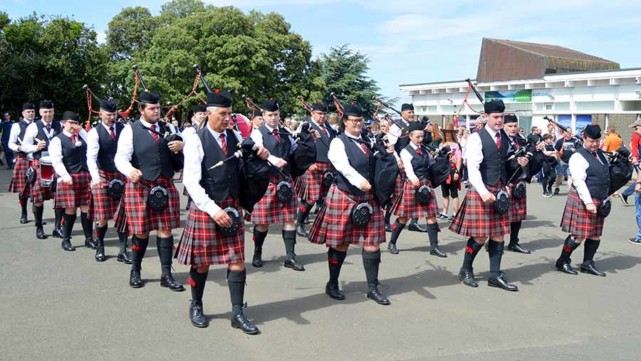 Bagpipers marching at the show