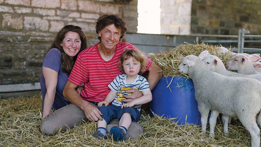 Thomas and Helen Garland with their son and lambs