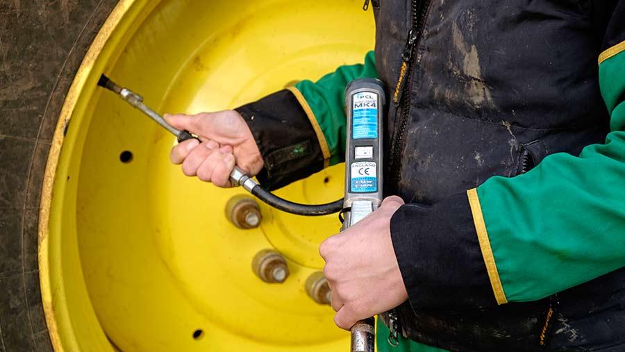 Checking tyre pressure on a sprayer ©Jason Bye