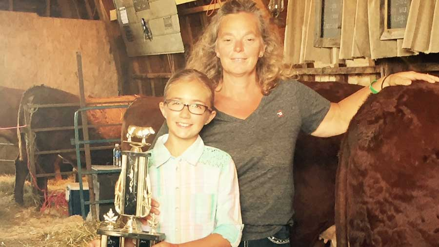 Kim Jo Bliss and niece pose for a photo with a trophy